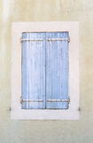 Old vintage rustic blue closed windows shutters French style arc. Hitecture. Vertical front view crop Royalty Free Stock Photo
