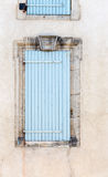Old vintage rustic blue closed windows shutters French style arc. Hitecture. Vertical front view crop Stock Photos