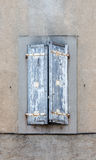 Old vintage rustic blue closed windows shutters French style arc. Hitecture. Vertical front view crop Royalty Free Stock Photography