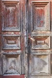 Old vintage rustic wood door. Old wooden red doors grey and red colors Royalty Free Stock Photo