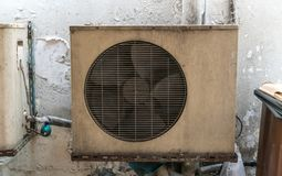 Old vintage rusting metal exterior fitted airconditioning unit m. Ounted on wall needing maintenance Royalty Free Stock Photography