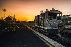Old vintage rusty railroad cars sitting on an old track Stock Photos