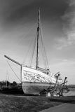 Old vintage sailboat in black and white. Being repaired on a pier royalty free stock image