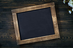 Old vintage school slate with flowers Royalty Free Stock Photo