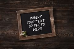 Old vintage school slate with flowers Royalty Free Stock Photos