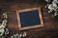 Old vintage school slate with flowers Stock Photography