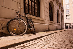 Old Vintage Sepia Bicycle Sidewalk Wall Stone Outdoors Ruined Worn Out Frame Street Cobblestone royalty free stock photography