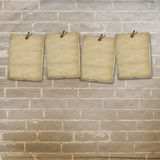 Old vintage sheets for advertisements on brick wall Royalty Free Stock Photo