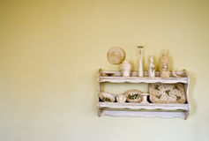 Old, vintage shelf. A classic restaurant detail, wooden shelf with vintage crockery. Yellow wall as space for text royalty free stock photo