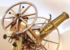 Old vintage shining brass telescope. Closeup photo Royalty Free Stock Images