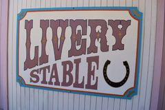 Livery stable sign from the wild west Stock Photography