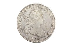 Old vintage silver dollar. Isolated on background Royalty Free Stock Photos