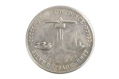 Old vintage silver dollar. Isolated on background Royalty Free Stock Photo
