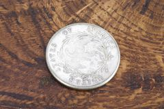 Old vintage silver dollar. On wooden background Stock Photos