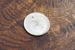 Old vintage silver dollar. On wooden background Royalty Free Stock Photography