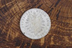 Old vintage silver dollar. On wooden background Royalty Free Stock Image