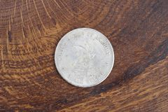 Old vintage silver dollar. On wooden background Stock Photography