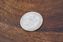 Old vintage silver dollar. On wooden background Stock Image