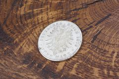 Old vintage silver dollar. On wooden background Royalty Free Stock Photo