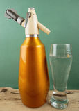 Old vintage siphon and glass of water Royalty Free Stock Photo