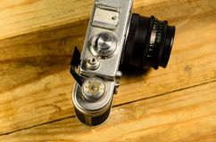 Old vintage soviet rangefinder camera and fountain pen Royalty Free Stock Image