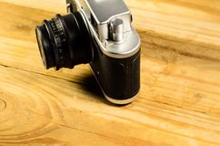 Old soviet rangefinder camera on a wooden table Stock Images