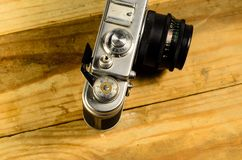 Old soviet rangefinder camera on a wooden table Stock Photo