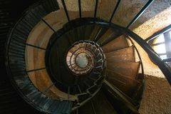 Old Vintage Spiral Staircase In Abandoned Mansion House. Top View. Architecture Details Concept royalty free stock photo