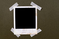 Old vintage stained polaroid style blank photo print frame sticky tape royalty free stock photos