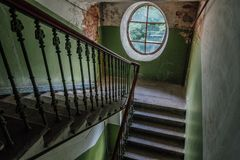 Old vintage staircase at the old house. Oval window stock photography