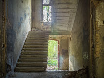 Old vintage stairs in abandoned building. Stock Photo