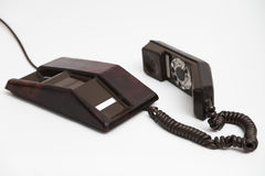 Old vintage stationary brown telephone with dial and a tube Stock Photography