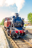 An old vintage steam train drive on the rails Stock Image