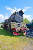 An old vintage steam train drive on the rails Royalty Free Stock Photo