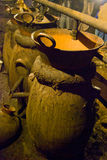 Old vintage still. Making mexican agave wine on a copper still in Mexico Royalty Free Stock Images