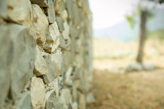 Old vintage stone wal with perspective view and blurred background Stock Image