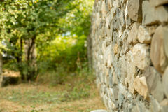 Old vintage stone wal with perspective view and blurred background Royalty Free Stock Image