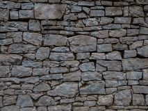 The old and vintage stone wall in a city.  Stock Photo