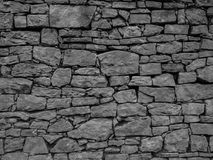 The old and vintage stone wall in a city.  Stock Images