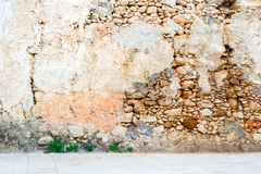 Old vintage stone wall interior. Old vintage broken stone wall interior Stock Photography