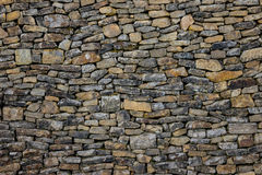 The old and vintage stone wall in a room.  Royalty Free Stock Image