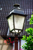 Old vintage street lamp in small city Royalty Free Stock Photo