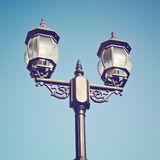 Old vintage street light against blue sky with retro effect Stock Photography
