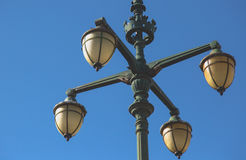 Old vintage street light with four arms on green cast iron poll Stock Photo