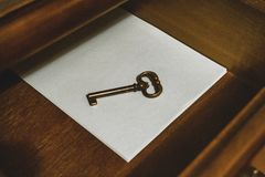 Old vintage style key in a wooden closet royalty free stock photo