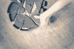 Old vintage style. person split a plate on the table Stock Images