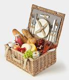 Old vintage style picnic hamper packed with food stock image