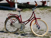 Old vintage style red bicycle in the beach. In Miami Florida Stock Photos