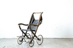 Old vintage style stroller in vintage room Stock Photo