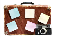 Old vintage suitcase and old camera on a white background. Royalty Free Stock Images